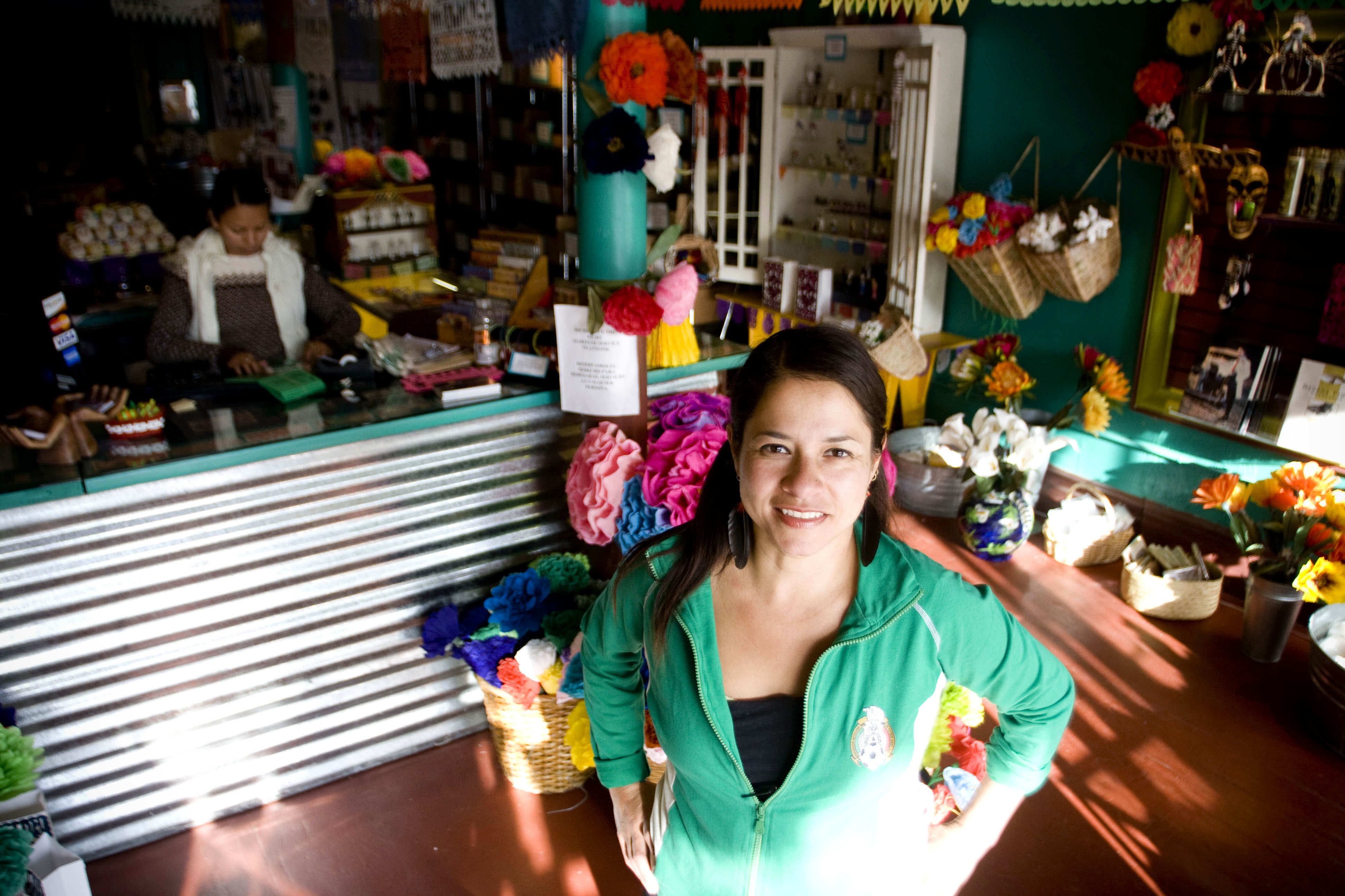 Nancy Charraga stands at the main entrance of her store, Casa Bonampak, located in the Mission District.