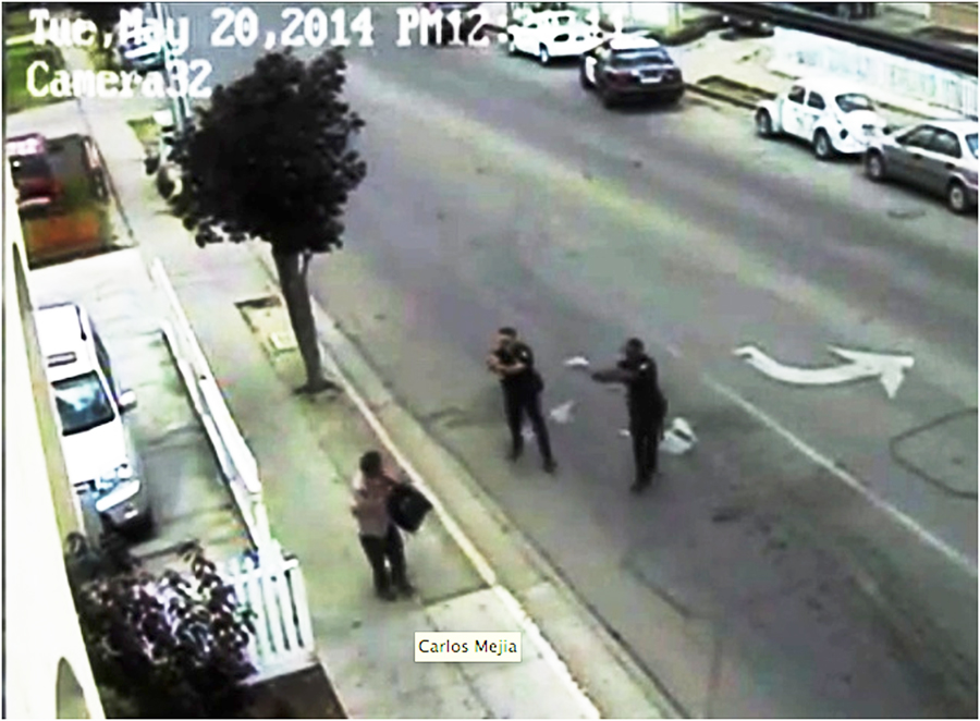 The two Salinas Police Department officers who shot Carlos Mejia on May 20 are seen here seconds before Mejia died. Security camera still courtesy KSBW.com