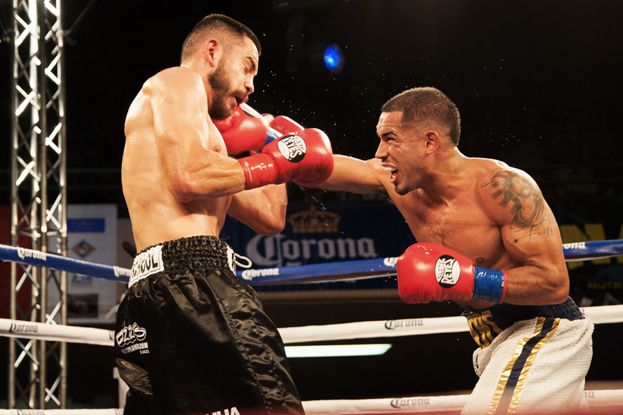 Jonathan Chicas, right, lands a right cross on Emmanuel Robles during their 8-round bout on July 18 at the Longshoremen's Hall in San Francisco. Chicas lost by split decision. Photo Santiago Mejia