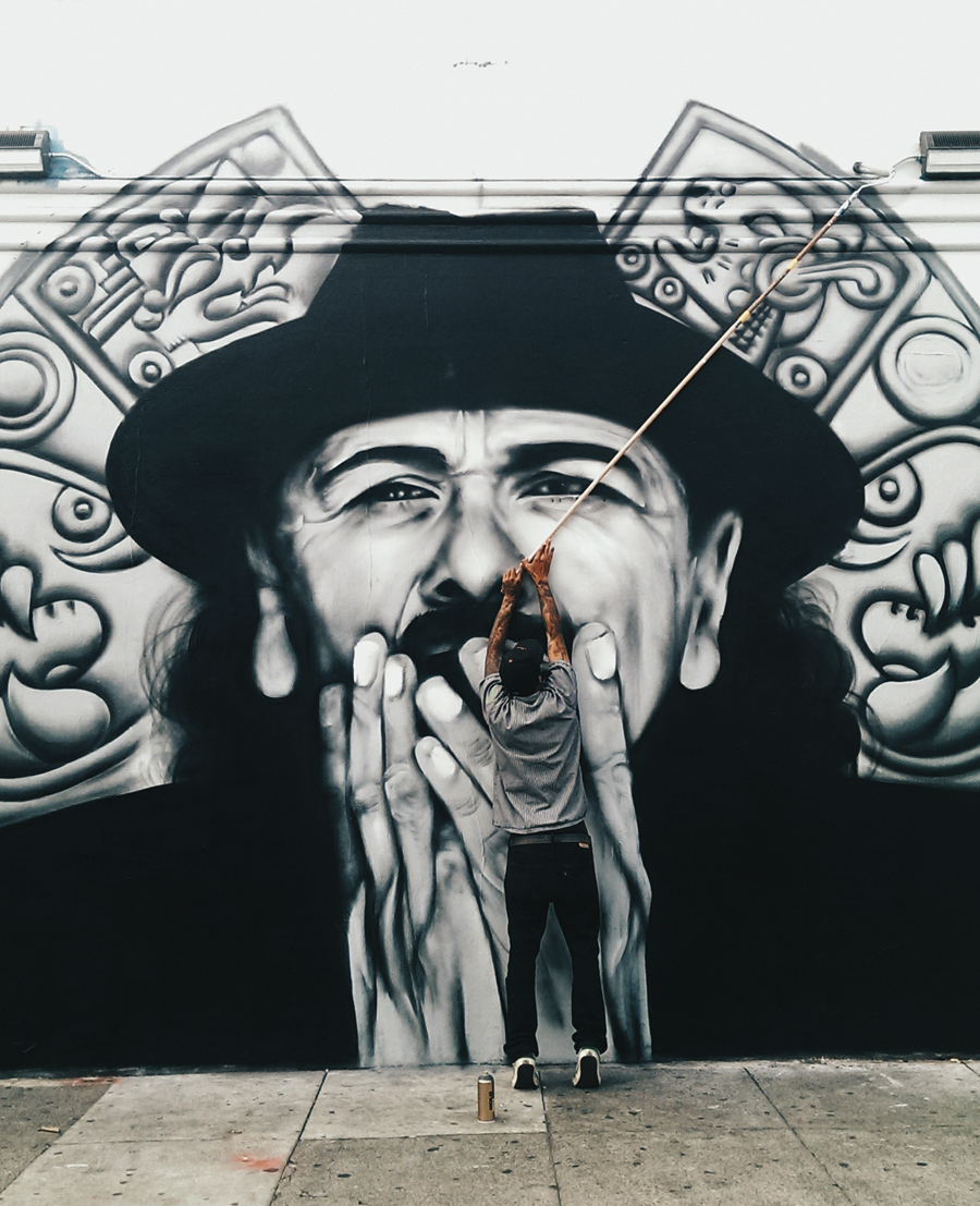 San Francisco muralist Mel Waters paints a mural of Carlos Santana on 19th Street near Mission. Photo Shane Menez