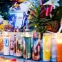 Altar durante la vigilia en honor a Jacob Valdiviezo, un joven de 19 años muerto el 30 de marzo de 2013 afuera de la casa de sus padres, en las calles Bryant y 24, a manos de un hombre que le preguntó a cuál pandilla pertenecía. Valdiviezo no pertenecía a ninguna pandilla, asistía a la universidad en Oregon y tenía una beca. Foto Shane Menez/El Tecolote Archives