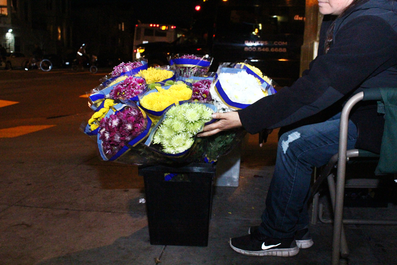 Marisol Ortega, who requested that her face not be photographed, has been selling flowers on 24th Street for 14 years. Photo Edgar Pacheco