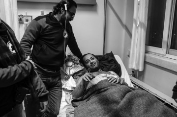 Mohammed Mustafa, founder of Free Syria Agency For Relief (left) and Talal Shawar, Syrian Refugee, recovering from hip replacement surgery in Antakya, Turkey. Photo Amos Gregory