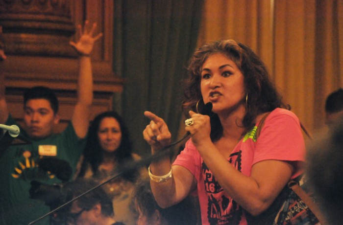Mission District resident Sandra Sandoval implores the board of supervisors to pass the moratorium on luxury housing in the Mission June 2. The meeting lasted nearly 10 hours as hundreds of residents voiced their support of the moratorium, which failed to gain the nine votes to pass. Photo Bridgid Skiba