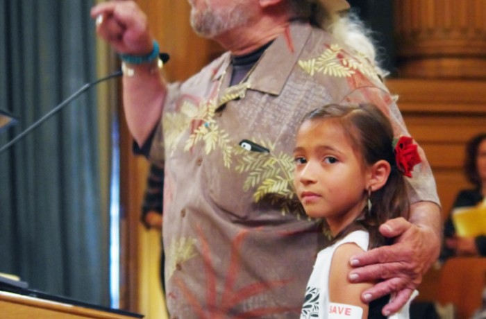 Mauricio Aviles and his granddaughter were two of the hundreds of Mission residents who spoke in support of the Mission moratorium during the nearly 10-hour board of supervisors meeting on June 2. Photo S. Thollot