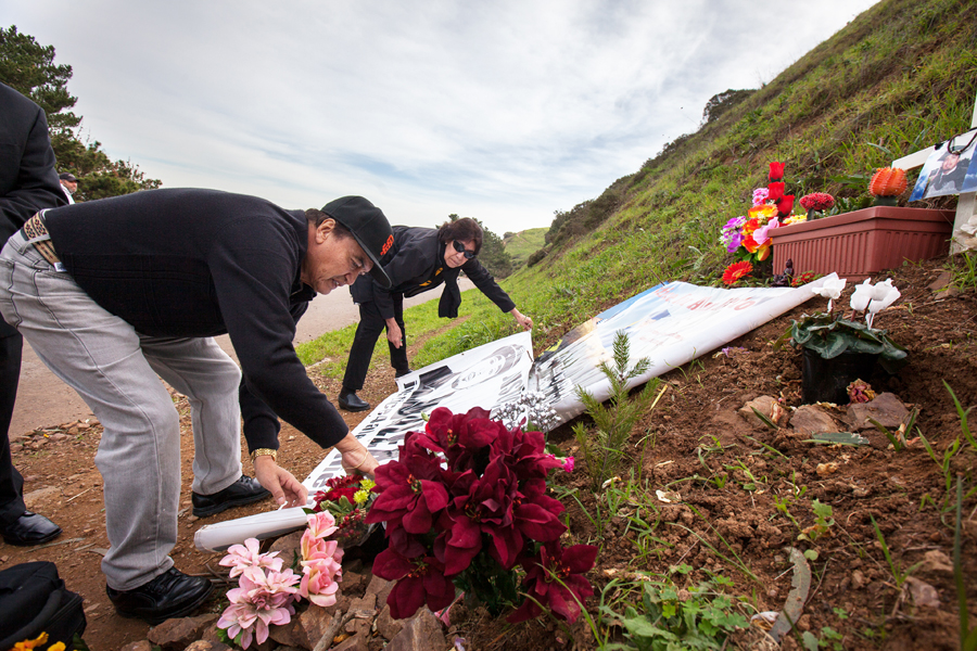 Refugio Nieto lays out a memorial for his son Alejandro Nieto, Monday, Jan. 5, 2015, in Bernal Heights Park. San Francisco police said they shot and killed Alejandro Nieto last March after he aimed a stun gun at them. Photo Santiago Mejia