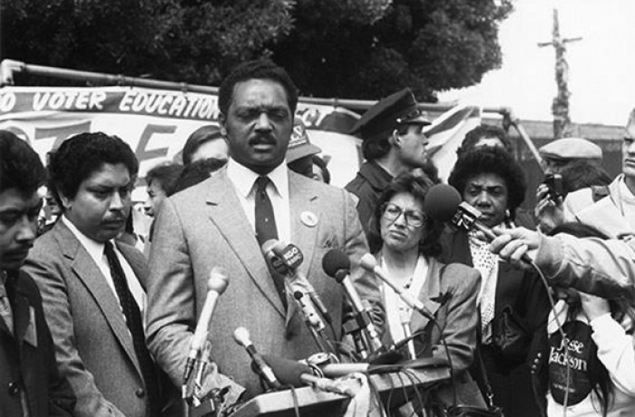 "Rosario Anaya stands to the right of Jesse Jackson in San Francisco during the ""Latinos for Jackson"" for president campaign in 1988. Courtesy San Francisco Latino Historical Society"