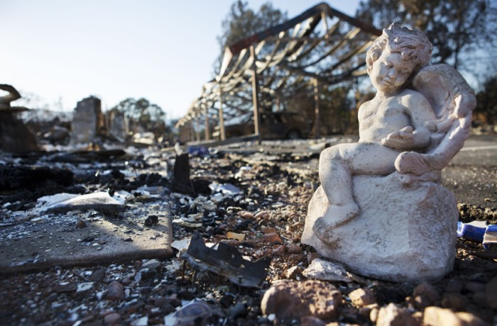 A stone cherub, one of few things to survive the wildfire that destroyed part of the city of Middletown, CA. Photo Manuel J. Orbegozo