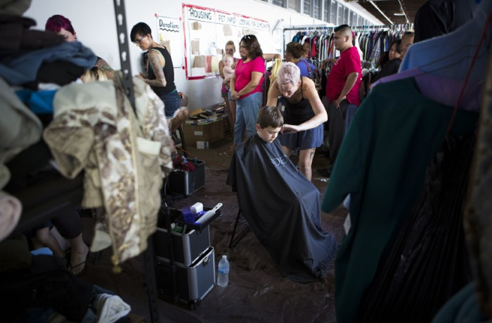 Chris Vargas, who lost his Middletown home during the fire, gets a free haircut at the Napa County Fairgrounds.
