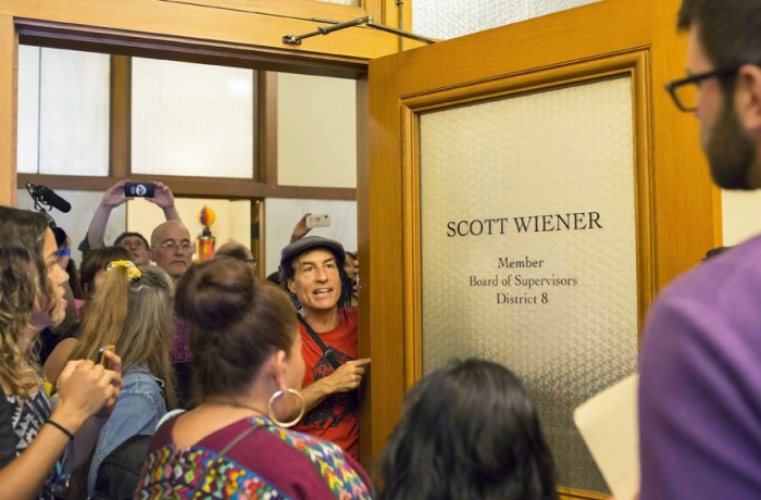 Tommi Avicolli Mecca at the door of District Supervisor Scott Wiener, one of the more vocal opponents against Prop I, which would call for a moratorium on luxury housing in the Mission District, Sept. 9. Photo Drago Rentería