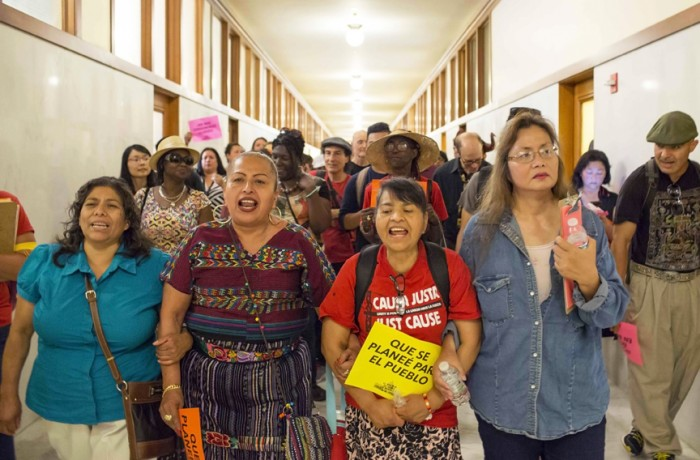 Mission District residents flood San Francisco City Hall on Sept. 9 to speak out against luxury housing, and to support Prop I, which will call for a moratorium on luxury development in the Mission. Photo Drago Rentería