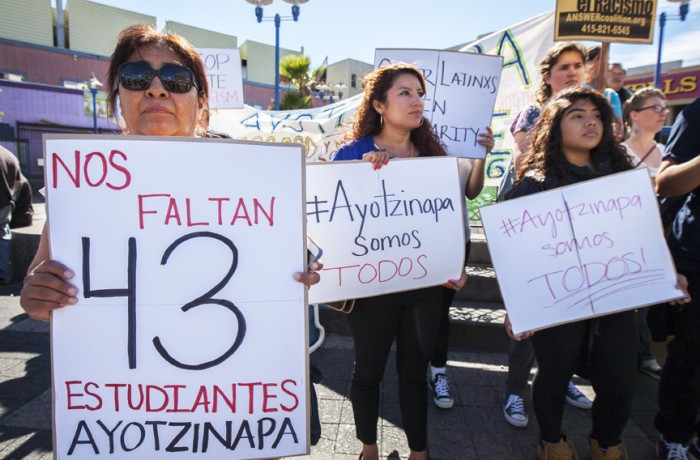 After marching from 24th Street, protesters rally at Mission and 16th streets during the Ayotzinapa one-year anniversary vigil on Saturday, Sept. 26. Photo Santiago Mejía