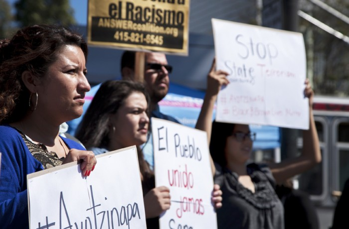 Gladys Puente (left) and protesters rally at Mission and 24th streets for the Ayotzinapa one-year anniversary vigil on Saturday, Sept. 26. Photo Santiago Mejía