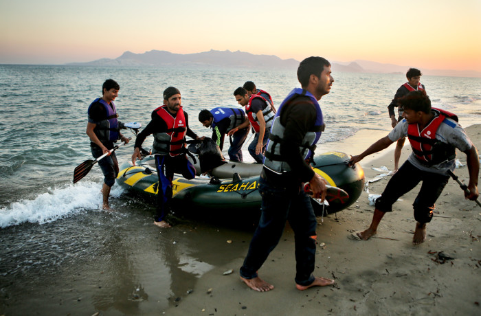 Eight Pakistani migrants arrive on the greek island of Kos on the morning of July 6, 2015. Like many, these migrants had to use paddles to row their way across the Aegean and Mediterranean seas to Europe because their small engine did not work. Migrants are sometimes not even supplied with an engine by smugglers. Photo Joel Angel Juárez