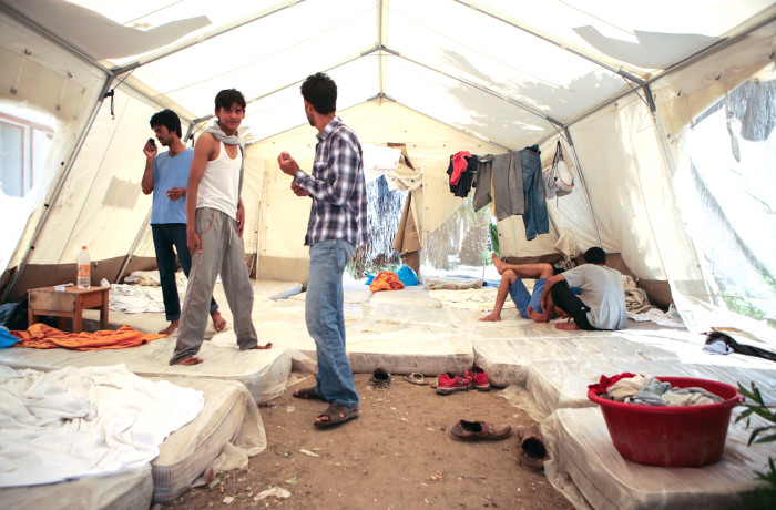 Pakistani migrants pass time in a tent set up by Doctors Without Borders on June 30, 2015. Some migrants sleeping in this tent had developed scabs on their skin since their arrival at the hotel claiming that bed bugs transmitted them. Photo Joel Angel Juárez