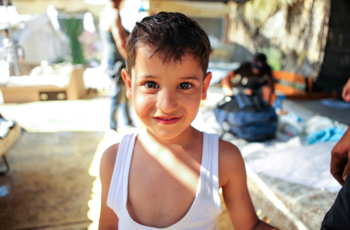 A Syrian refugee poses for a portrait at the Hotel Captain Elias in Kos, Greece on July 2, 2015. Migrants and refugees making the dangerous journey across the Mediterranean and Aegean seas into Europe risk the lives of their children with hopes for a better future for their families. Photo Joel Angel Juárez