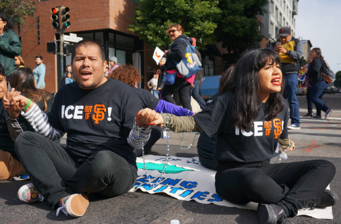 Amid the rising number of Immigration and Customs Enforcement raids throughout Latino communities nationwide, immigration activists organized actions in San Francisco and Los Angeles on the morning of Jan. 26. In San Francisco, 16 protesters were arrested after chaining themselves together, blocking traffic at two intersection near the ICE headquarters. Photo Reyna Maldonado