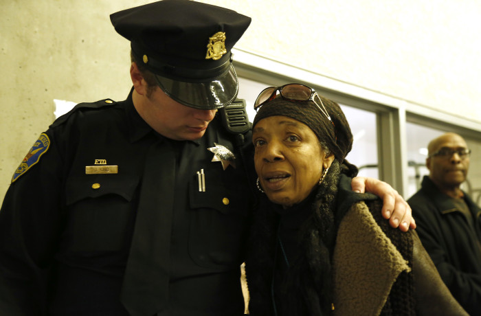 San Francisco police officer J. King reassures Mario Woods supporter Sharen Hewitt during public comment at the San Francisco Police Commission meeting at the Salvation Army Kroc Center on Jan. 20 in San Francisco. Photo Emma Marie Chiang