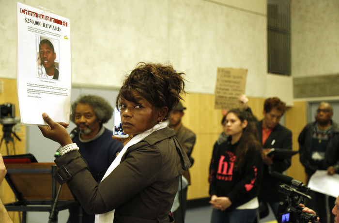 Paulette Brown, mother of 17-year-old Aubrey Abrakasa Jr. who was shot several times in the Northern Panhandle neighborhood in 2006, holds a sign in remembrance of her son during public comment at the San Francisco Police Commission meeting at the Salvation Army Kroc Center on Jan. 20 in San Francisco. Photo Emma Marie Chiang