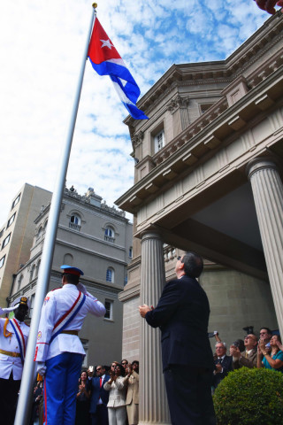 The Cuban flag is raised at the embassy in Washington. Photo Bill Hackwell