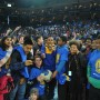 Actor Hill Harper poses for a selfie with a group of students at Oracle Arena in Oakland on Jan. 27. The event