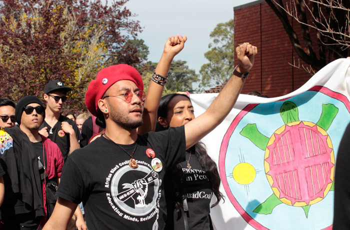 Spulu Pacific, 24, at the front of the crowd walking to the Cesar Chavez Center at San Francisco State University on Feb. 25, 2016. The group was protesting of the proposed budget cuts to the Ethnic Studies department. Photo Brenna Cruz