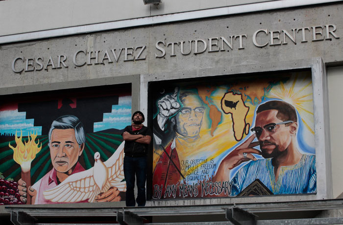 "Ivan De Los Santos, 27, on top of the Cesar Chavez Student Center at San Francisco State University on Feb. 25, 2016. ""Great to be here with my idols,"" De Los Santos said. Photo Brenna Cruz"