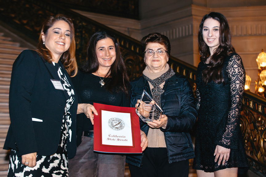 Rosario Anaya's family accepting her NEN Hall of Fame award: (left) Menée Soliz Hill (niece), Monica Montoya (niece) y Carlota Soliz (sister). Photo Amanda Trescott