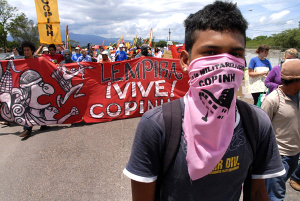 Consejo Cívico de Organizaciones Populares (COPINH) participating in a march in Palmerola, Honduras, 2011. According to Global Witness, Honduras has the highest murder rate of environmental activists in the world. (Photo: Felipe Canova / Flickr)