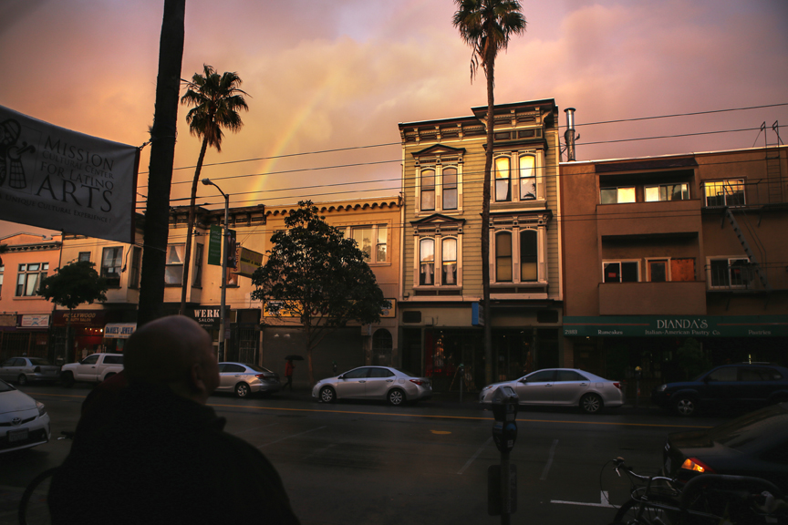 A rainbow appears during a community gathering at the Mission Cultural Center for Latino Arts to mark the two-year-anniversary of Alex Nieto's fatal shooting by SFPD in San Francisco on March 21, 2016. The rainbow appeared as community members took a moment of silence for Nieto around the same time that he was shot two years ago.