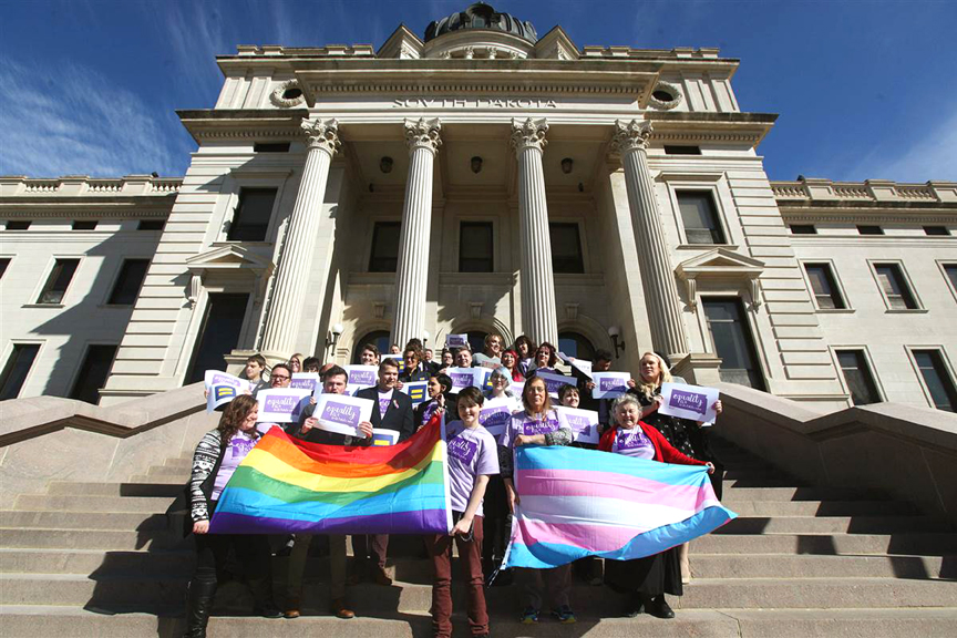 Representatives from the Center for Equality, American Civil Liberties Union of South Dakota, LGBT supporters and members of the Human Rights Campaign stand on the front steps of the State Capitol, on Feb. 23, 2016. Photo via Time.com