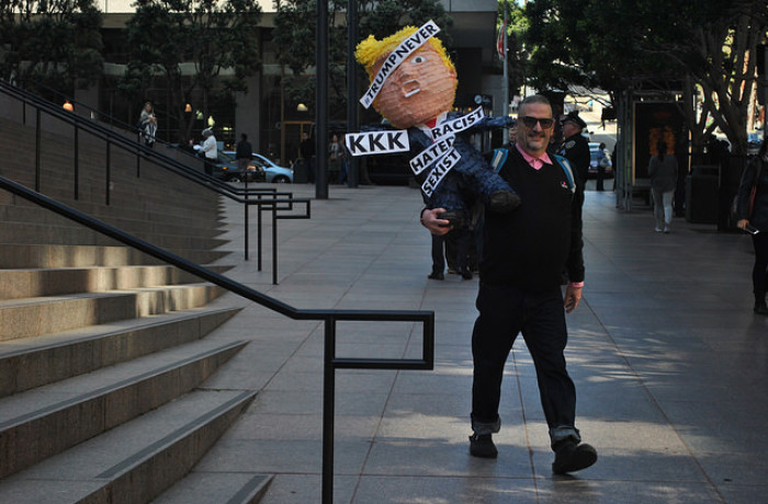"Michael Petrelis heads to the front entrance of the ""Triple 5"" building, which is 30 percent owned by The Trump Organization, to protest Donald Trump's presidential candidacy. Photo Alejandro Galicia Diaz"