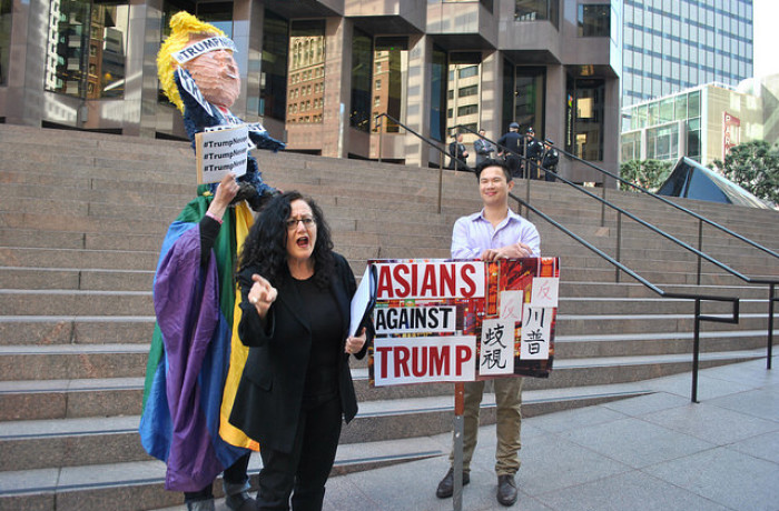 (From left) Michael Petrelis, Melanie Nathan of the African Human Rights Coalition and Jeffrey Qwong protest Donald Trump's presidential candidacy on Super Tuesday. Photo Alejandro Galicia Diaz