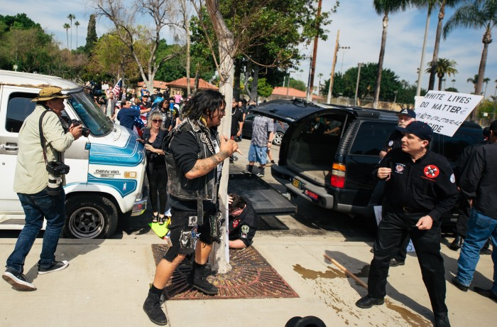 Anti-KKK protester Armando Campos (center) and San Francisco resident and Klansman Charles Edward Donner (right) square off during the melee that broke out at the KKK rally in Anaheim on Feb. 27. Photo courtesy of Eric Hood/OC Weekly