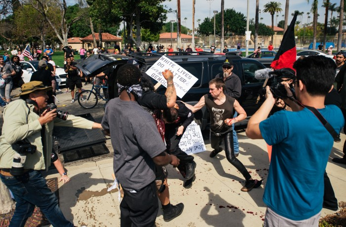 San Francisco resident and Klansman Charles Edward Donner (center) being attacked by two Anti-KKK protesters during the melee that broke out at the KKK rally in Anaheim on Feb. 27. Photo courtesy of Eric Hood/OC Weekly