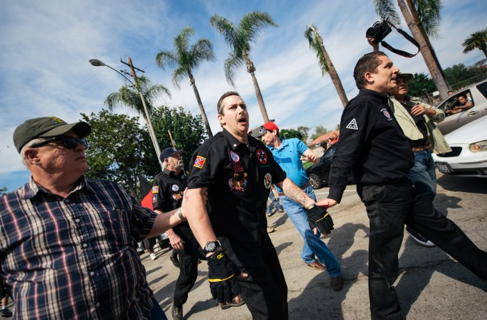 San Francisco resident and Klansman Charles Edward Donner (right) helps Ku Klux Klan leader William Quigg during the melee that broke out at the KKK rally in Anaheim on Feb. 27. Photo courtesy of Eric Hood/OC Weekly