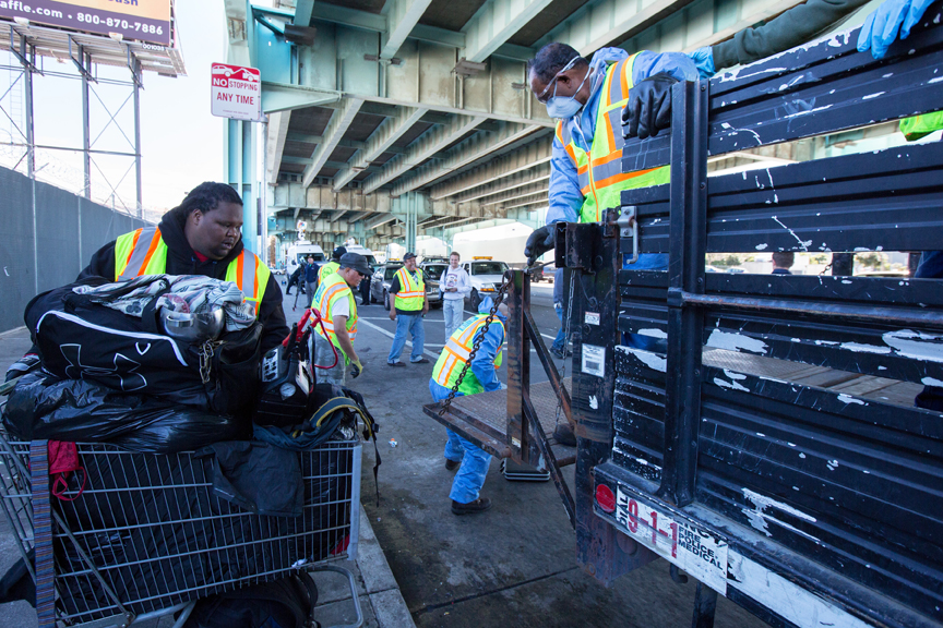 """Crews from the San Francisco Department of Public Works """"clean up"""" the homeless encampment along Division Street on March 1, after city officials declared the encampment a public health hazard. Photo Santiago Mejia."""