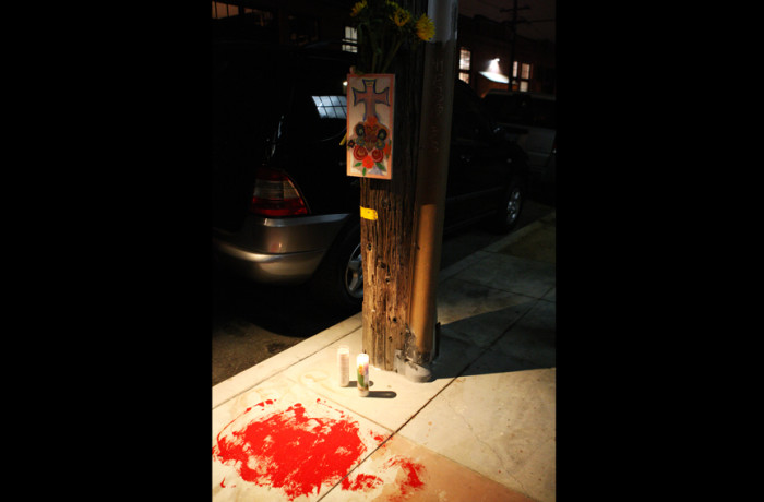 Candles and red paint cover the site of the fatal officer-involved shooting of Luis Gongora, a homeless man, who was killed earlier that day on Shotwell Street between 18th and 19th streets in San Francisco on April 7, 2016. Photo Joel Angel Juárez