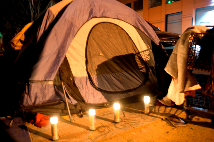 Memorial created by the homeless encampment community for Luis Gongora in front of his tent. Photo Amos Gregory