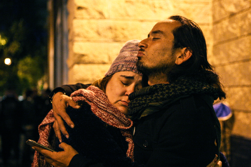 Sandra Vasquez (left) hugs Ilyich Sato (right), a Bay Area rapper known as Equipto, in front of the Mission Police Station during day five of a hunger strike demanding the resignation of SFPD Police Chief Greg Suhr in San Francisco on April 25.   Hunger strikers were threatened with arrest and were also denied bathroom access that night.