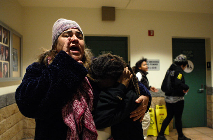 Sandra Vasquez (left) and Amaya Cristina (right), 10, shouts demanding that the restrooms remain open after officers at the Mission Police Station denied access to hunger strikers during day five of a hunger strike. Vasquez and Cristina were forced to use a neighbor's restroom around the block. The officers later agreed to re-open the restroom facilities in the building. Photo Joel Angel Juárez