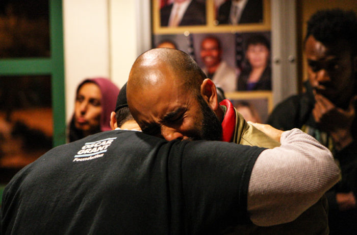 Al Osorio (left) hugs Edwin Lindo (right) after officers at the Mission Police Station refused to open the bathrooms in the building for at least two pregnant women and a child during day five of a hunger strike. Photo Joel Angel Juárez