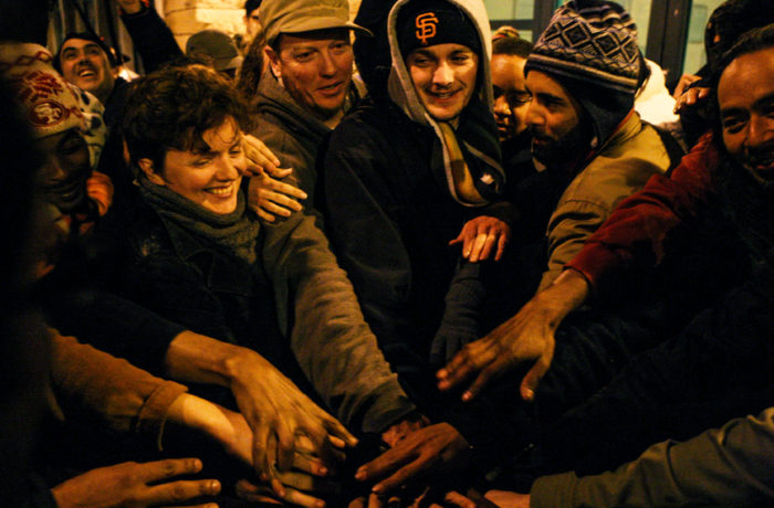 Protestors put their hands together celebrating another night of a hunger strike at the Mission Police Station on April 25. Photo Joel Angel Juárez