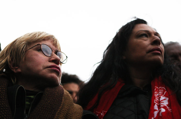 Maria Cristina Gutierrez (left) and Mary Mendoza (right) listen as protestors rally outside the Mission Police Station after SFPD Captain Daniel Perea cancelled a monthly community meeting during day six of a hunger strike. Photo Joel Angel Juárez