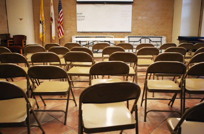 Empty chairs are seen inside a room on April 26 where monthly community meetings are held at the Mission Police Station in San Francisco. SFPD Captain Daniel Perea cancelled the monthly community meeting after hunger striker Edwin Lindo demanded that the meeting be held outside to accommodate the overflow of people waiting outside and were not allowed in during day six of a hunger strike. Photo Joel Angel Juárez