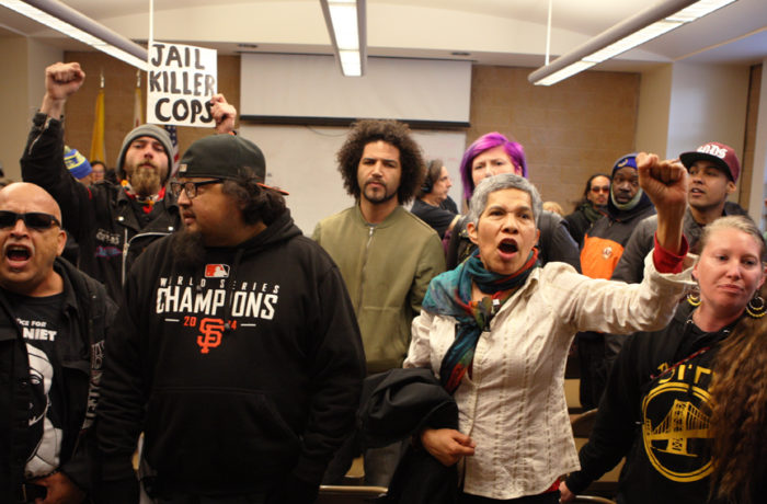 Protestors shout at SFPD Captain Daniel Perea after he cancelled a monthly community meeting held at the Mission Police Station during day six of a hunger strike. Photo Joel Angel Juárez