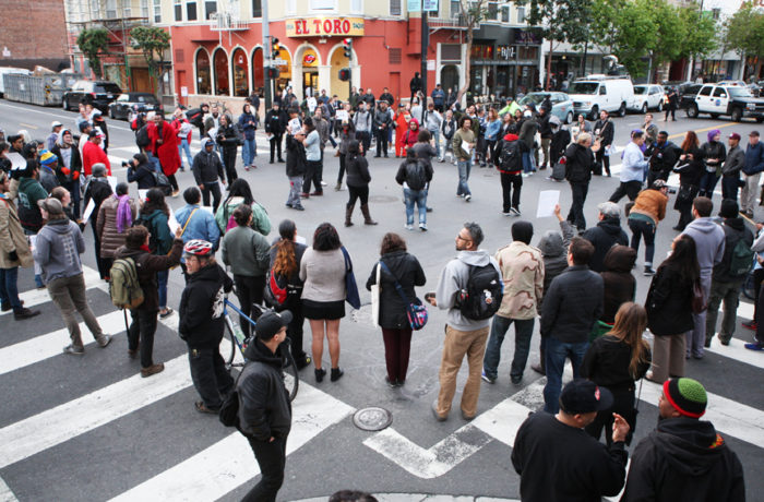 Protestors occupy the intersection of Valencia and 17th streets after SFPD Captain Daniel Perea cancelled a monthly community meeting at the Mission Police Station during day six of a hunger strike. Photo Joel Angel Juárez