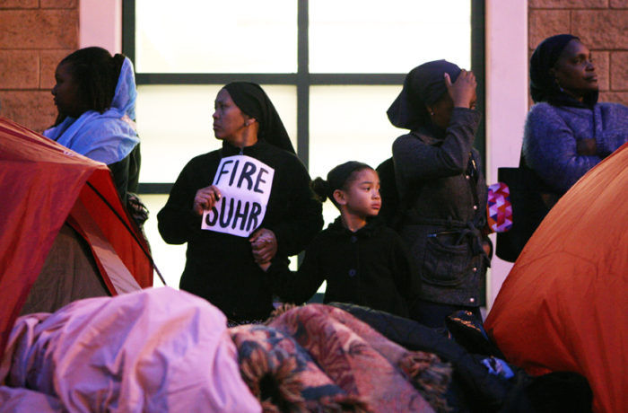 Protestors stand in front of the Mission Police Station after occupying the intersection of Valencia and 17th streets after SFPD Captain Daniel Perea cancelled a monthly community meeting during day six of a hunger strike. Photo Joel Angel Juárez