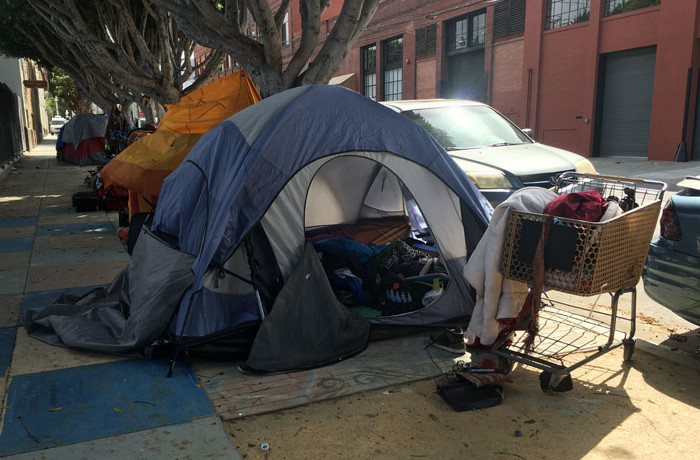The tent of an adult latino male who was fatally shot by SFPD on Thursday morning is seen vacant on Shotwell Street between 18th and 19th streets in San Francisco on April 7, 2016. Photo Joel Angel Juárez