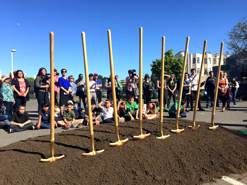 Children, community members and city officials look over eight ceremonial shovels during the groundbreaking celebration of the new park at 17th and Folsom streets. Photo Courtesy of PODER